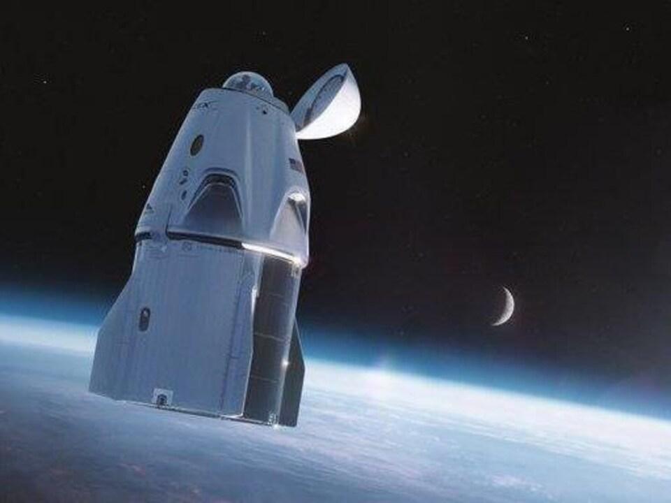 Illustration de la capsule Crew Dragon en orbite terrestre.