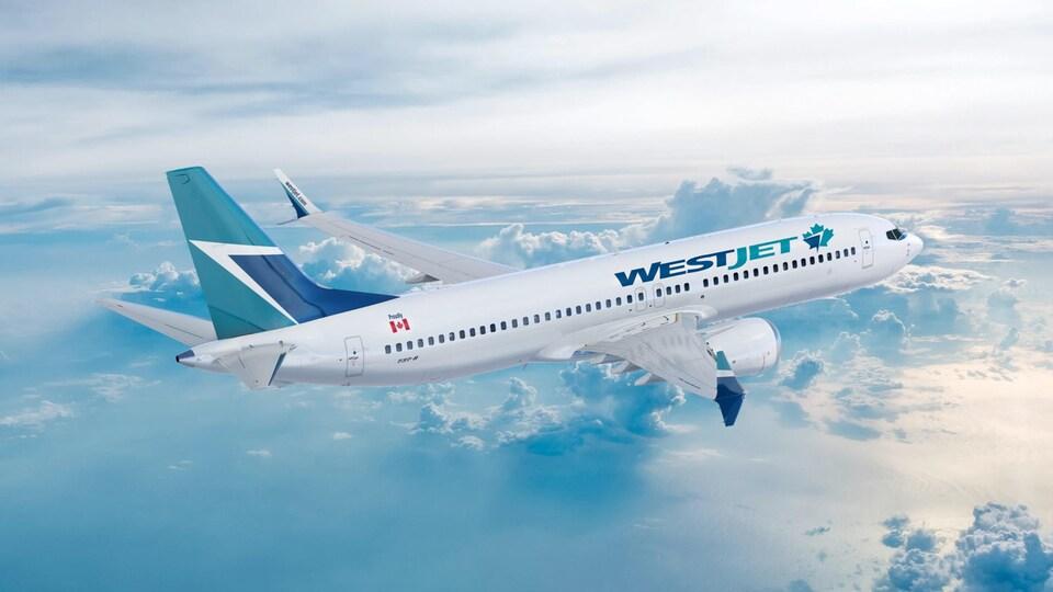 Un Boeing 737 MAX de WestJet volant au-dessus des nuages.