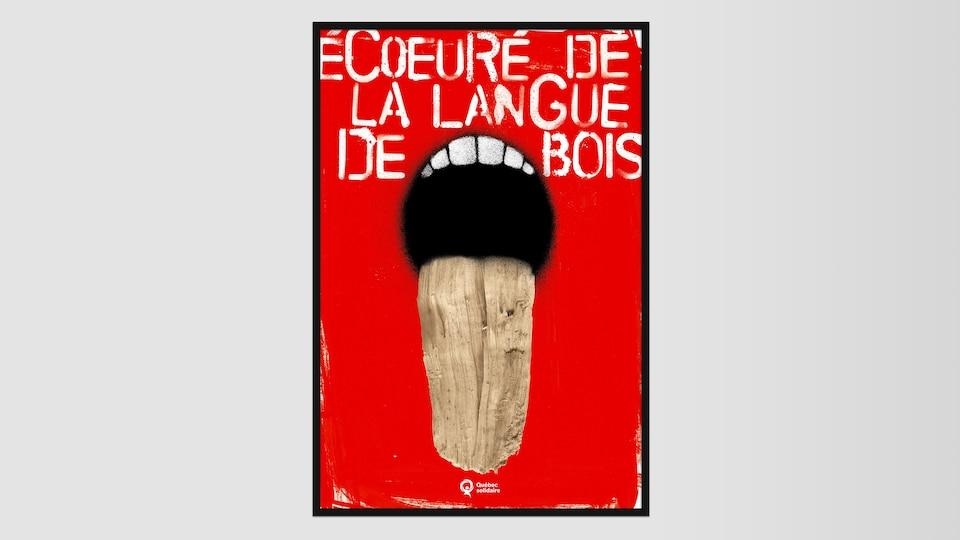 On lit «Écoeuré de la langue de bois» sur un fond rouge. Une bouche qui tire la lange, celle=ci est faite de bois.
