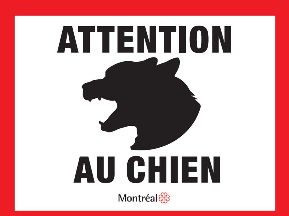 Un dessin de chien montrant les dents et semblant aboyer se trouve sur une affiche de la Ville de Montréal. On peut lire sur l'affiche «Attention au chien» et «Montréal».