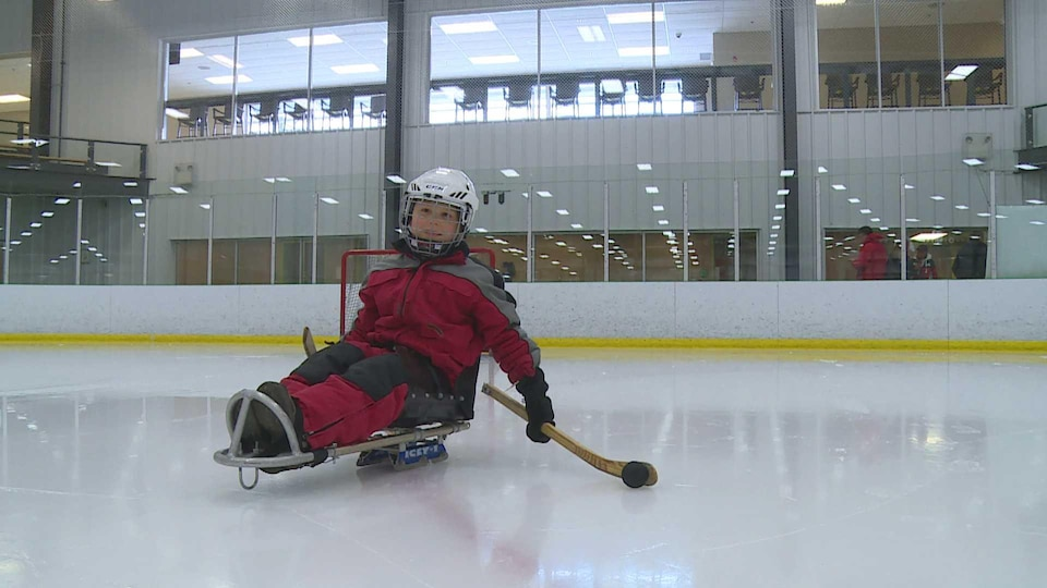 Younger sled hockey followers introduce the Olympic athlete