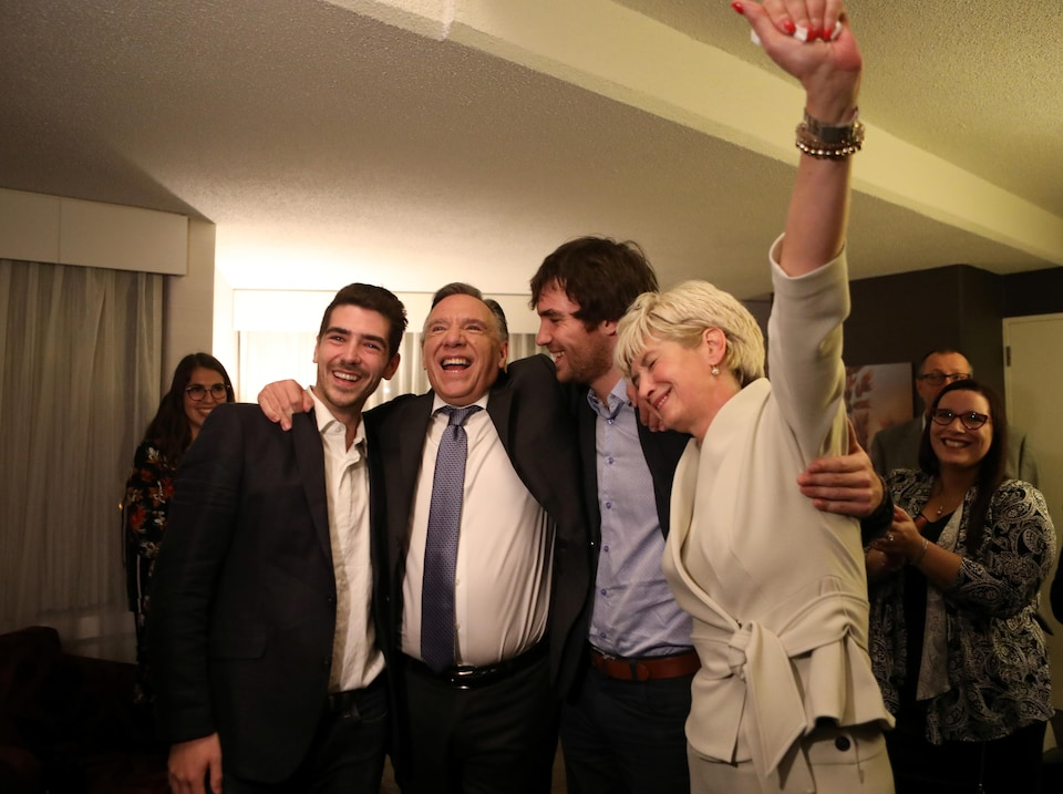 François Legault en compagnie de sa femme et de ses deux fils