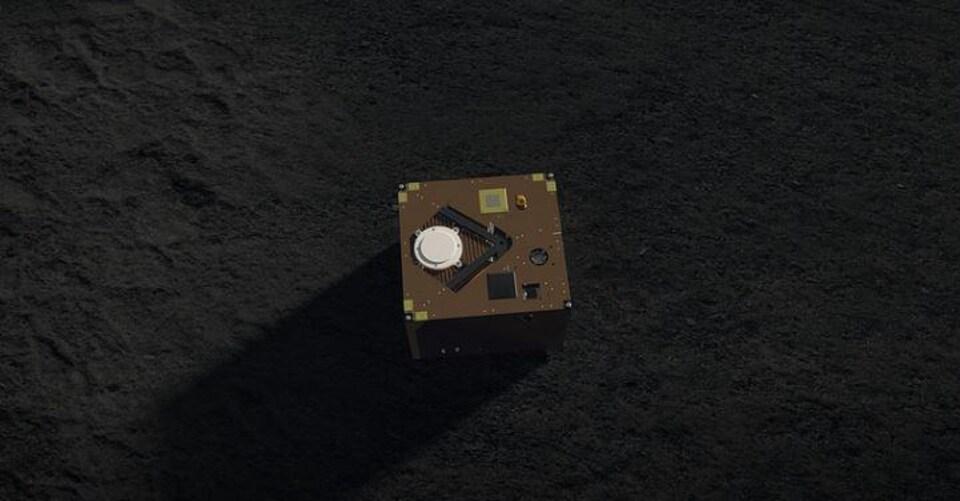 Représentation artistique du robot MASCOT à la surface de Ryugu.