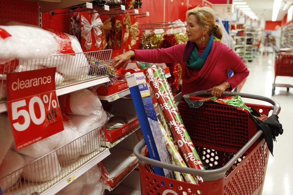 Holly Bryan stocks up on Christmas wrapping paper and other holiday items while shopping for day after Christmas deals at a Target store in Chattanooga, Tenn. Wednesday, Dec. 26, 2012. (AP Photo/Chattanooga Times Free Press, Dan Henry) THE DAILY CITIZEN OUT; NOOGA.COM OUT; CLEVELAND DAILY BANNER OUT; LOCAL INTERNET OUT