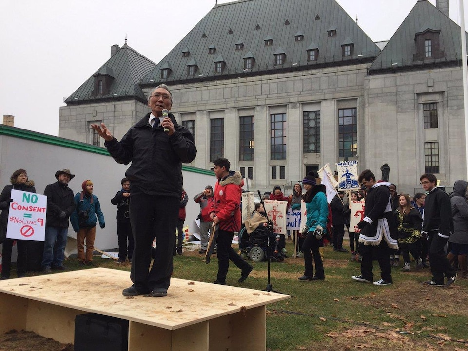 Clyde River mayor James Qillaq addresses a crowd of supporters in Ottawa, thanking them for 'supporting our community and our way of life' in advance of the Nunavut hamlet's Supreme Court hearing Wednesday afternoon. (Waubgeshig Rice/CBC)