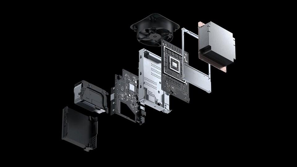 La Xbox Series X, décomposée. On y voit toutes ses parties internes. Cela ressemble à une tour d'ordinateur.