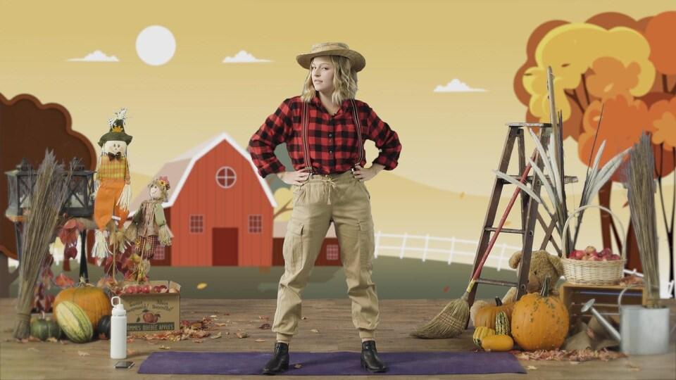Une entraîneuse de gymnastique est déguisée pour l'Halloween dans un cours en ligne.