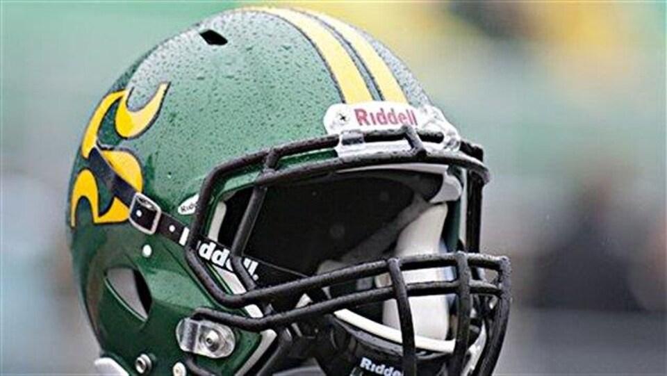 Un casque aux couleurs du Vert & Or de l'Université de Sherbrooke