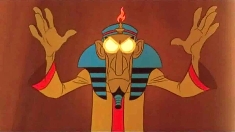 Capture d'écran d'un film d'animation pour enfant présentant un hypnotiseur les mains levées et les yeux ronds et blancs.