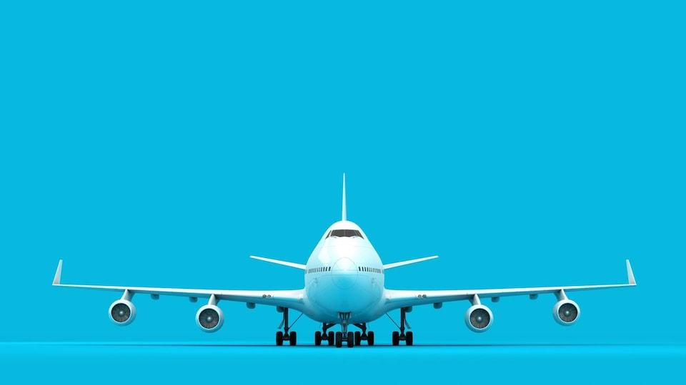 L'avion vu de face, sur fond bleu, prêt à décoller.
