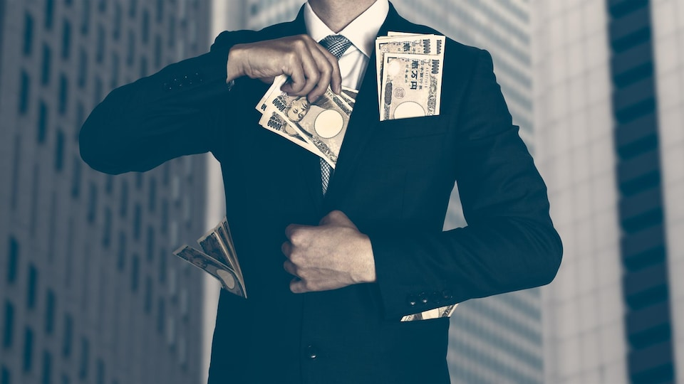 A man, framed photo of his trunk, his pockets full of bills of different currencies.
