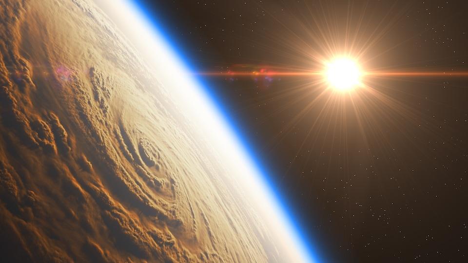 Lever de soleil sur un ouragan, vu de l'espace.