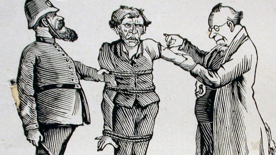 Un homme ligoté se fait vacciner de force.