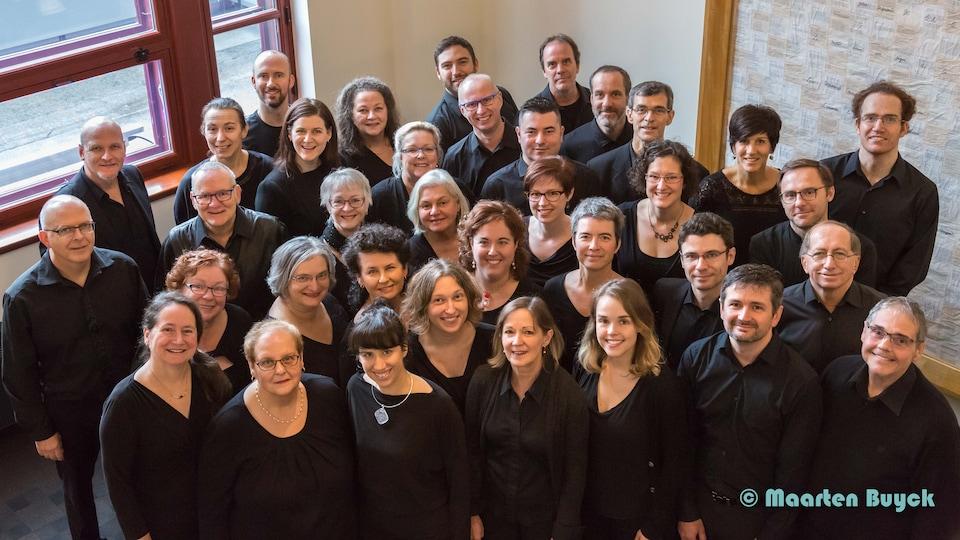 Le choeur des Rhapsodes participera à l'international de Musique Sacrée. Les chanteurs sont tout sourire.