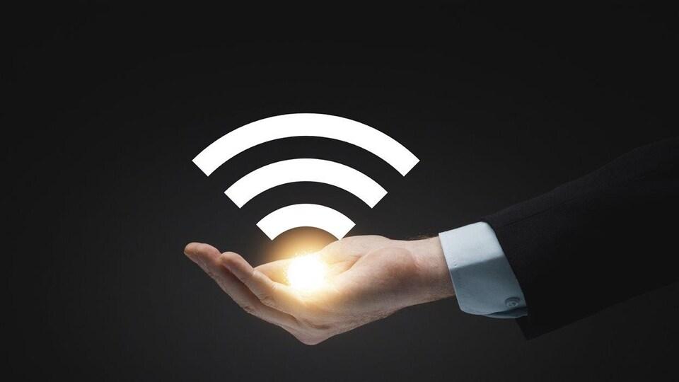 Une main tournée vers le haut dans laquelle apparait une lumière et le logo habituellement associé à un réseau sans-fil.