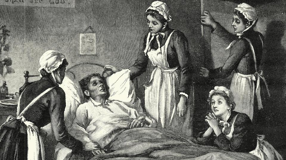 Des infirmières prodiguent des soins à un homme souffrant de tuberculose.