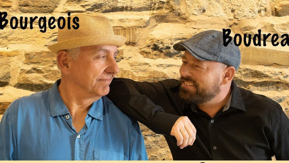 Ronald Bourgeois et Danny Boudreau se regardent d'un air complice.