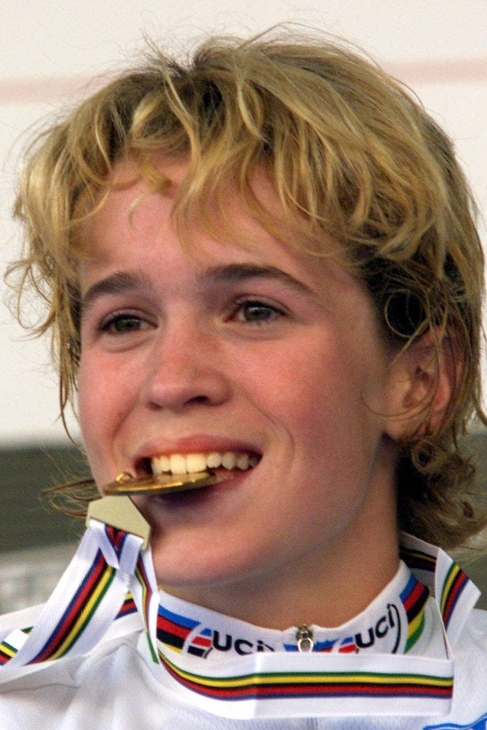 Genevieve Jeanson of Canada bites the gold medal after  winning the women's junior road race at the World Cycling Championships in Verona, Italy, Friday, October 8,1999. (AP Photo/Michael Probst)