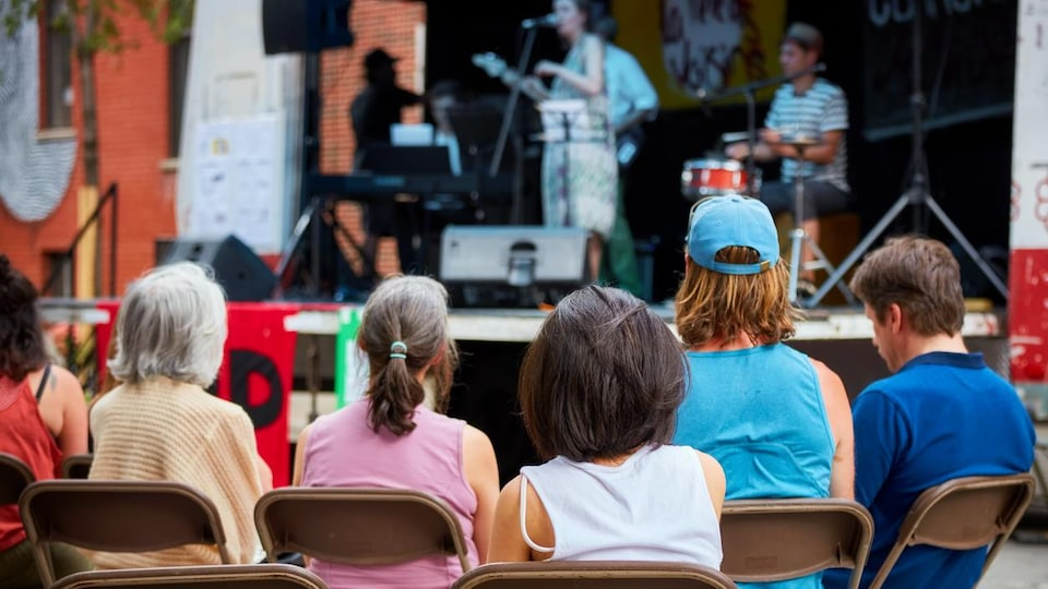 Montreal, Canada - June 2018. Audiences watch a local jazz band perform on an outdoor stage in Montreal, Quebec, Canada.  Editorial application.