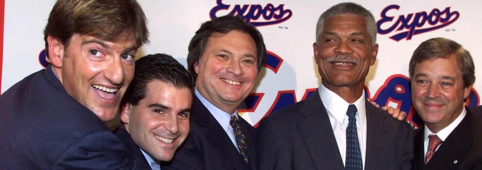 Stephen Bronfman, David Samson, Jeffrey Loria, Felipe Alou et Jacques Ménard lors de la conférence de presse du 9 décembre 1999 à Montréal.(CP PHOTO/Paul Chiasson)