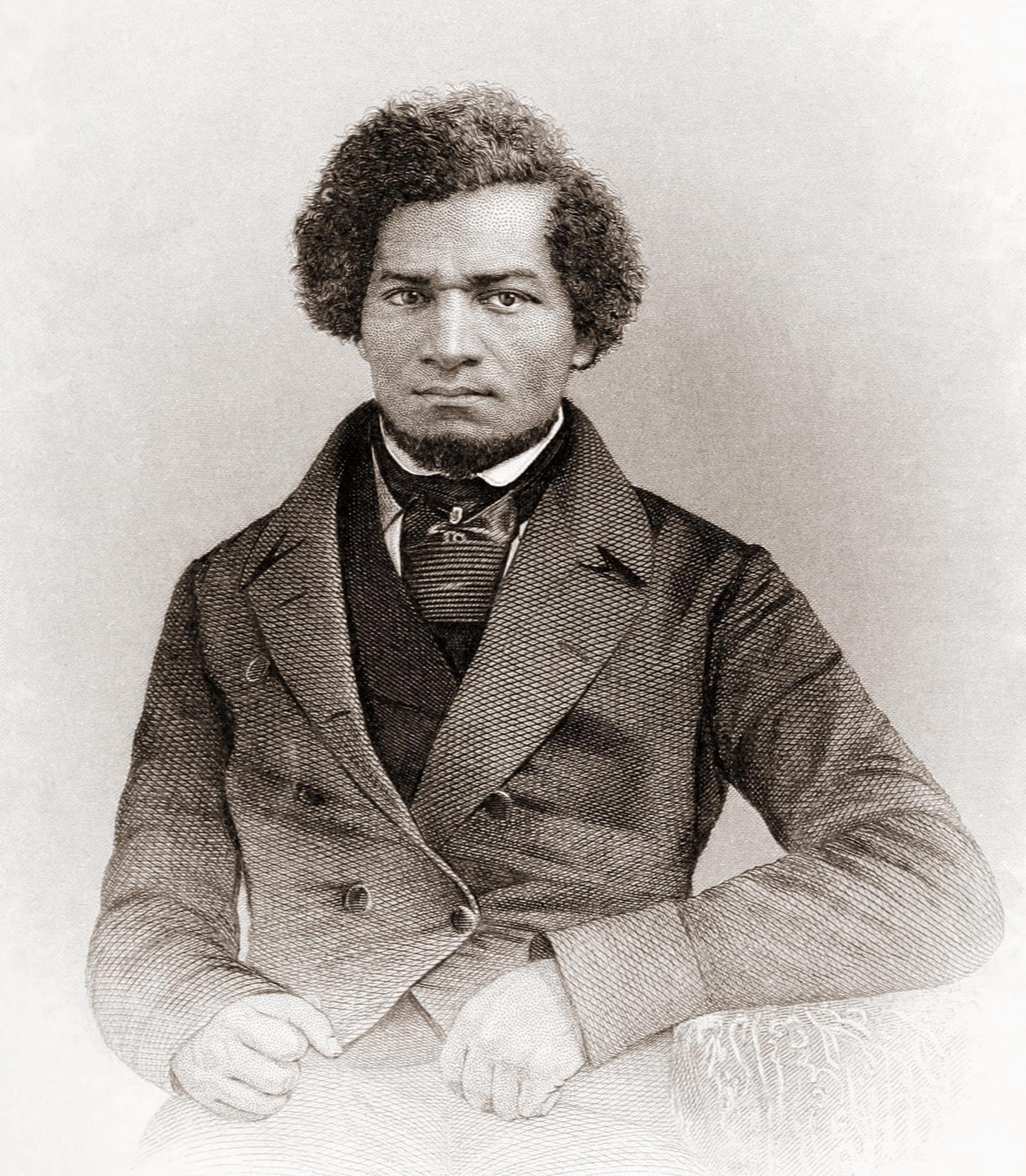 Portrait en noir et blanc d'un homme en costume.