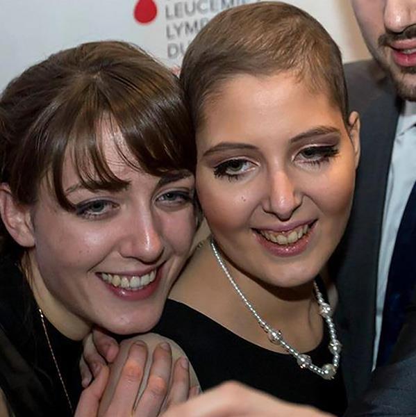 Jenifer et sa famille lors d'une activité de collecte de fonds pour le cancer