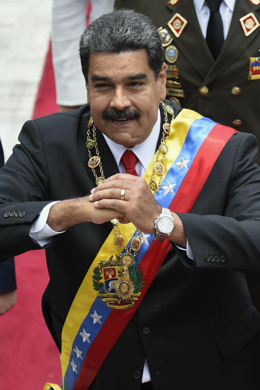 Nicolas Maduro et sa femme Cilia Flores arrivent au Congrès pour la cérémonie d'investiture le 24 mai 2018, à Caracas.