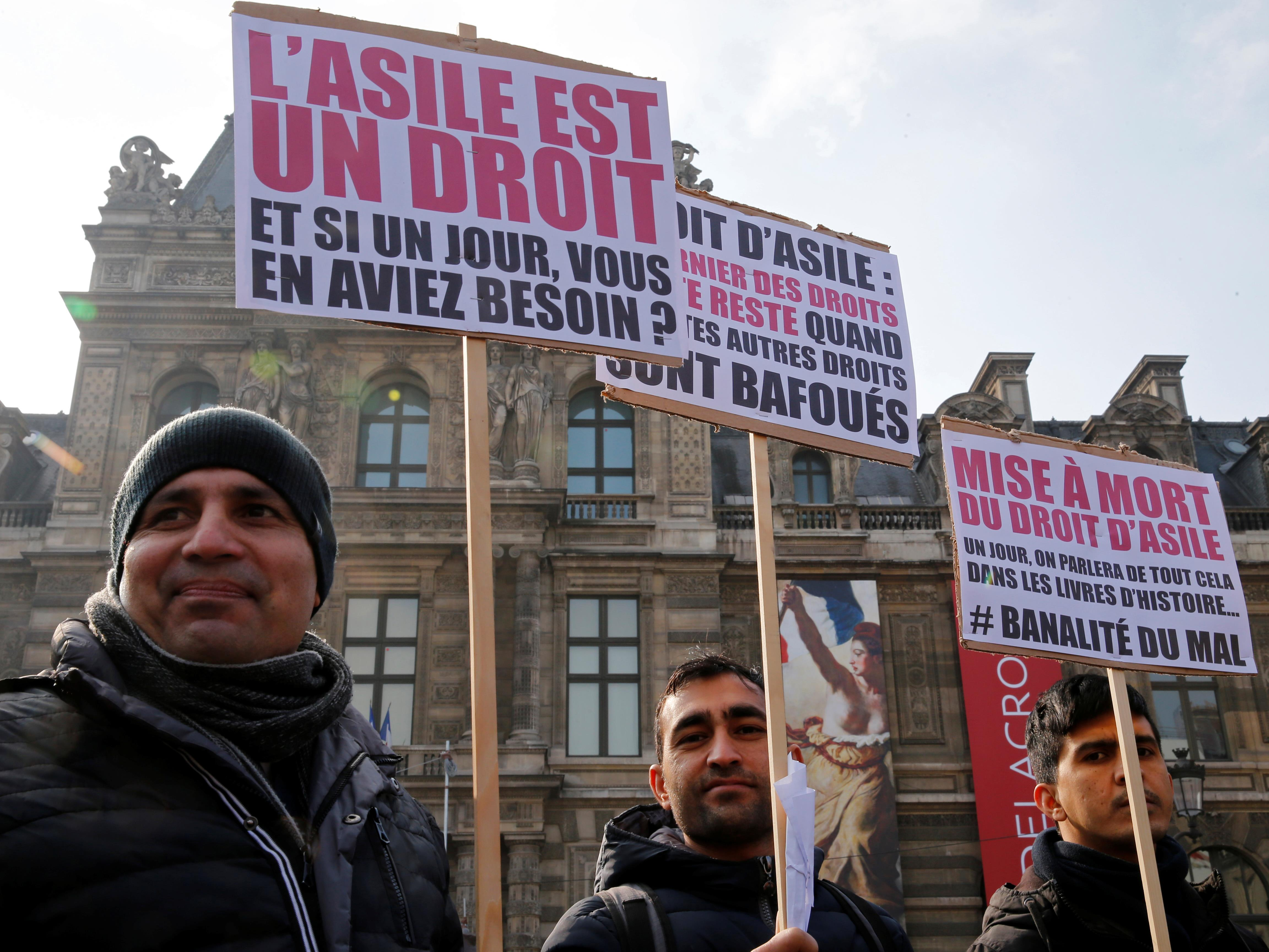 Des migrants manifestent à Paris en février 2018 contre un projet de loi asile et immigration controversé.