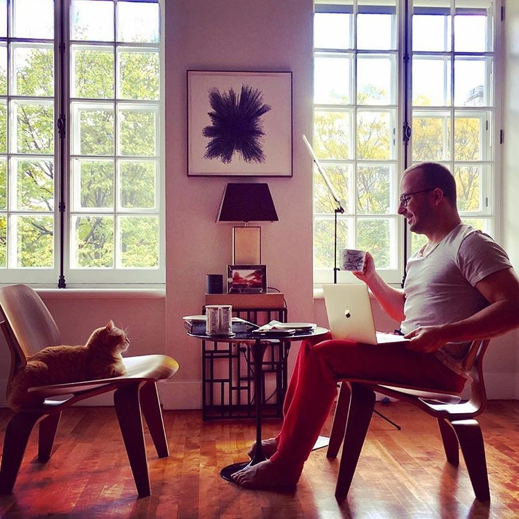 Conductor Yannick Nézet-Séguin enjoys an early morning moment with his cat at his home in Old Montreal.