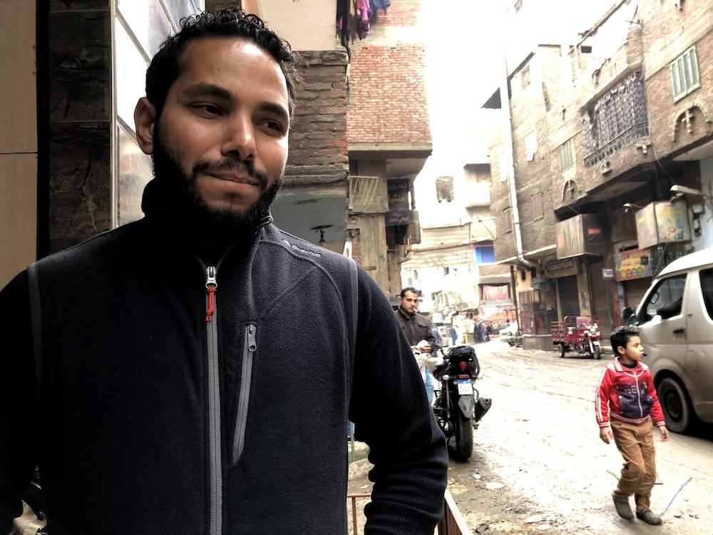 Adham El-Sharkawy, la mine désolée, dans la cité-ordures de Manshiyat Nasser.