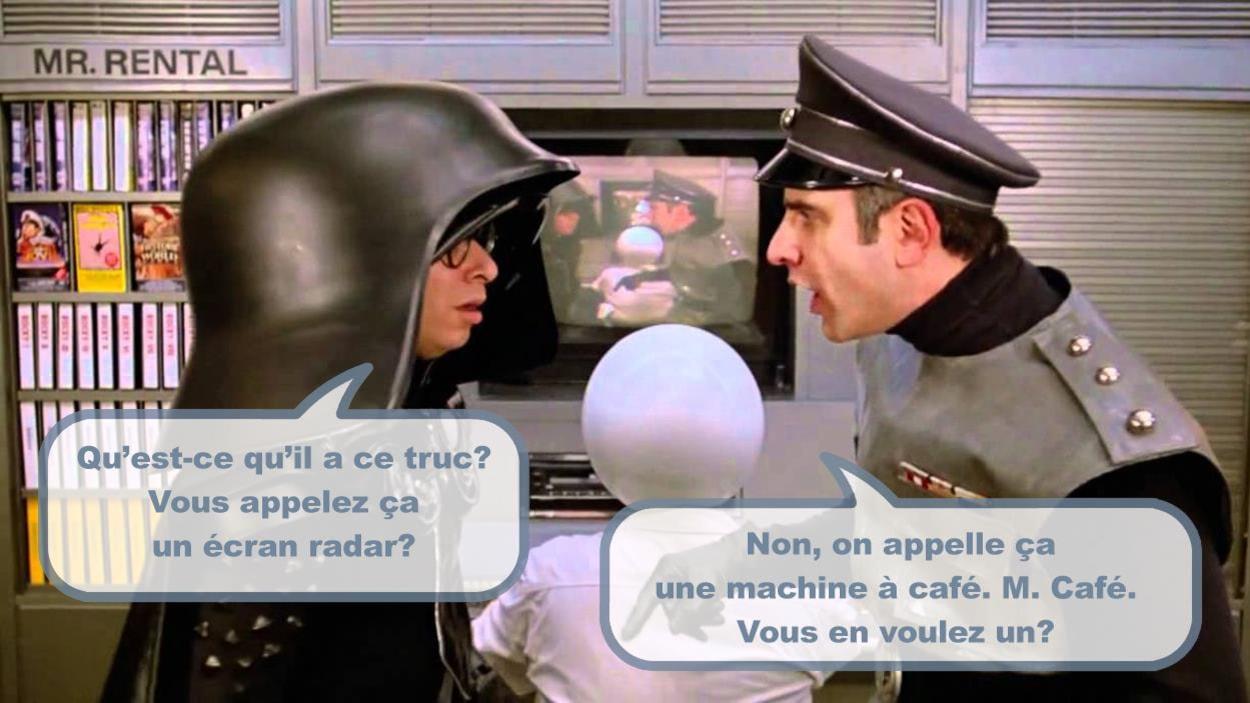 Deux hommes en tenues d'officier de l'espace et ce dialogue entre eux: Qu'est-ce qu'il a ce truc? Vous appelez ça un écran radar? Non, on appelle ça une machine à café. M. Café. Vous en voulez un?