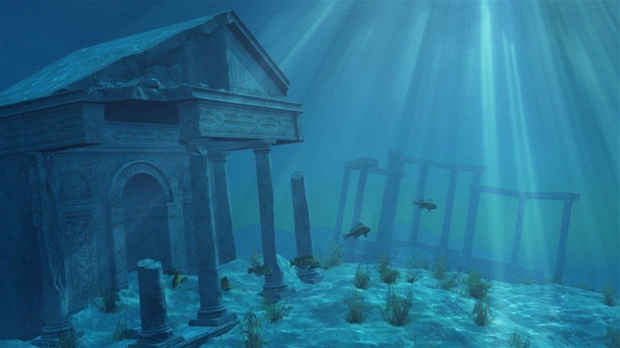 Sous l'océan, des poissons visitent les ruines de l'Atlantide.