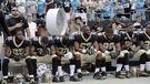 Des joueurs de la NFL défient Trump