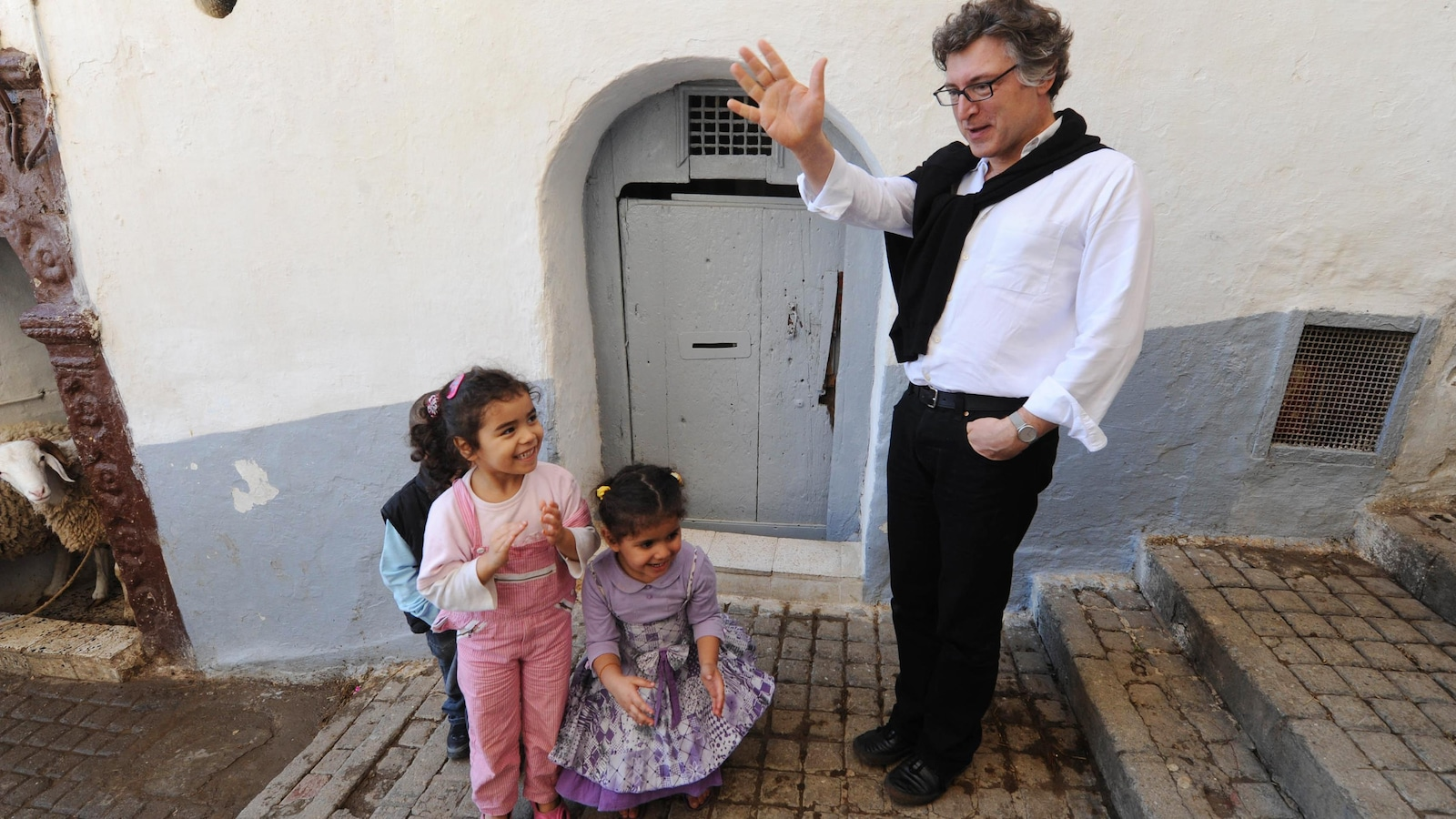 French philosopher Michel Onfray (R) speaks to children in the Casbah of Algiers on November 2, 2011. AFP PHOTO / FAROUK BATICHE        (Photo credit should read FAROUK BATICHE/AFP/Getty Images)