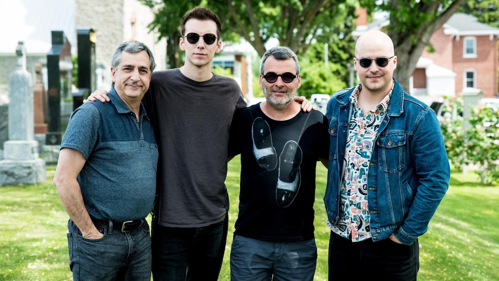 Martin Drainville, Pier-Luc Funk, Serge Boucher et Marc-André Grondin posent en groupe pour une photo.