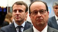 Le président français François Hollande en compagnie d'Emmanuel Macron