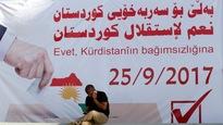 Une publicité appelant les électeurs à participer au référendum du 25 septembre, à Kirkouk.