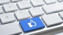 Un « J'aime » de Facebook sur une touche de clavier d'ordinateur