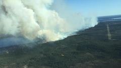 Un feu de forêt quadruple de taille au Manitoba