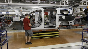 Steve Vince works on a 2017 Chrysler Pacifica on the assembly line at the Windsor Assembly Plant, Friday, May 6, 2016, in Windsor, Ontario. Fiat Chrysler Automobiles and Google announced Tuesday, May 3, that they will work together to more than double the size of Google's self-driving vehicle fleet by adding 100 Chrysler Pacifica minivans. (AP Photo/Carlos Osorio)