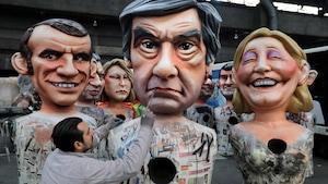 Des figures géantes des candidats présidentiels français lors du Carnaval de Nice de 2017