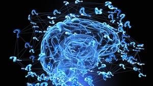 Un cerveau modélisé en trois dimensions entouré de points d'interrogation.