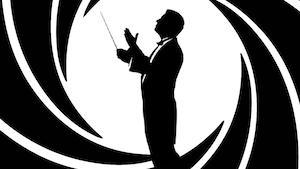 Une silhouette de chef d'orchestre se tient dans un rond blanc et noir, à la manière des films de James Bond.