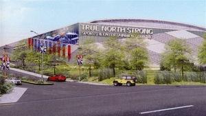 Un dessin d'aréna entouré d'arbres affichant l'inscription True North Strong