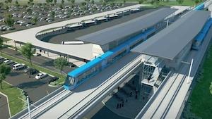 Une rame de train entre en gare.