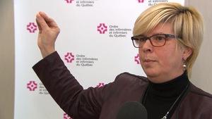 Lucie Tremblay au micro d'un journaliste.