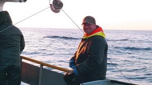 Un pêcheur de crabe sur son bateau