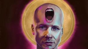 Un dessin représentant John Cameron Mitchell avec une bouche  ouverte sur le front.