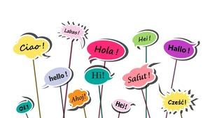 Des bulles multicolores portent des mots en diverses langues comme salut, hello et hola.