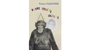 La couverture du livre : On y voit le dessin d'un singe et le visage d'une femme qui surgit derrière l'épaule de l'animal.